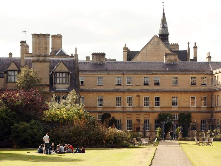 Students relax in the grounds of Oxford University's Trinity College.