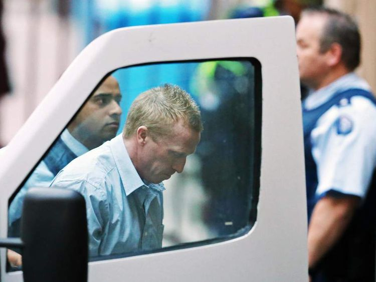 Adrian Bayley, center, is taken from a prison van and led into the Melbourne Supreme court in Melbourne