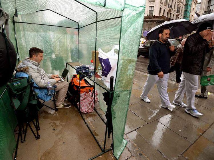 Teenagers outside Apple Store in London