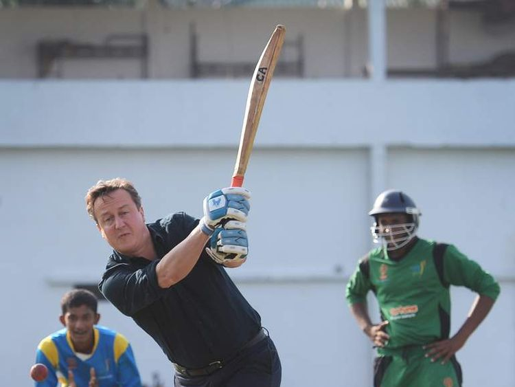 Prime Minister David Cameron plays cricket in Sri Lanka
