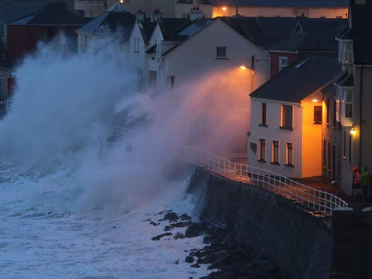Large waves caused by high winds and spring tides batter the coastal town of Lahinc
