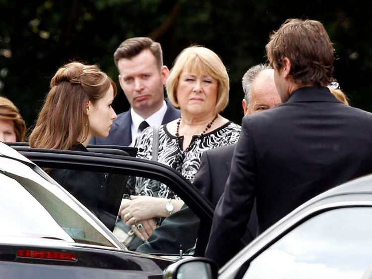 Ann Maguire's family arrive for the teacher's funeral.