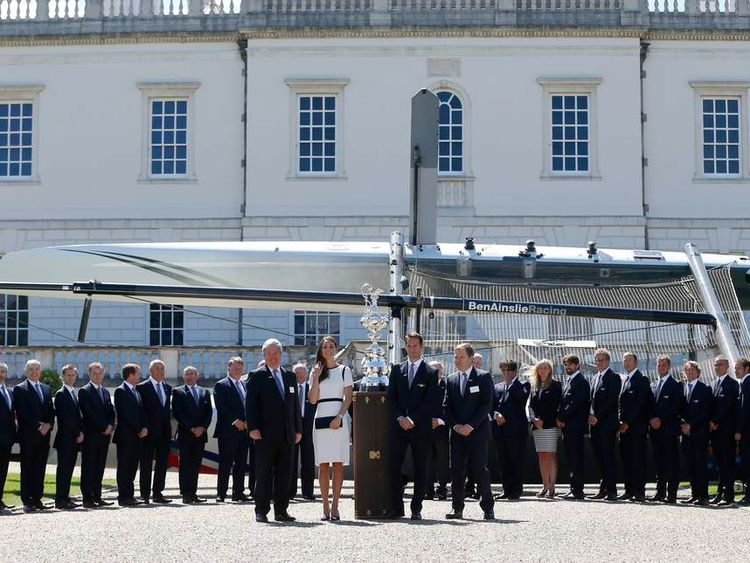 The Duchess of Cambridge (front row, second left) poses with members of Ainslie Racing team, their boat behind and the America's Cup, during the launch of British challenger team for the 35th America's Cup