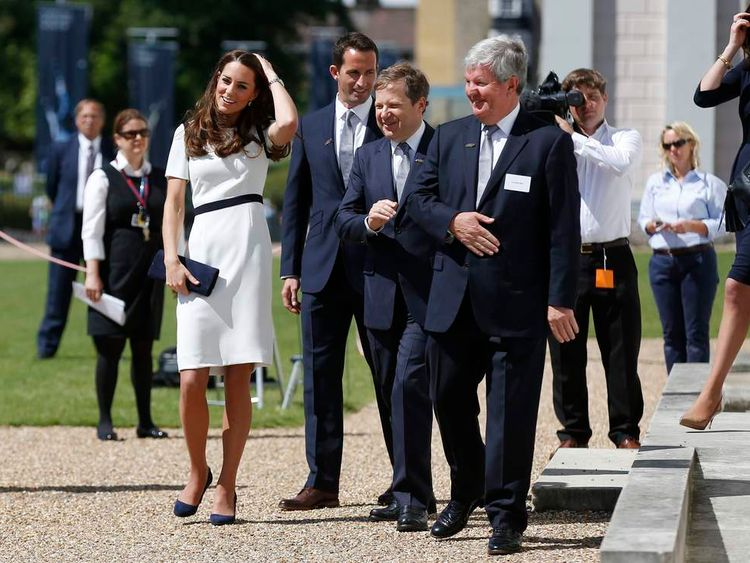Duchess of Cambridge (left) walks with Sir Ben Ainslie (second left), Sir Charles Dunstone, co-founder of Carphone Warehouse (second right) and Sir Keith Mills, entrepreneur and deputy chairman of London Organising Committe of the 2012 Olympic Games, during the launch of British challenger team for the 35th America's Cup.
