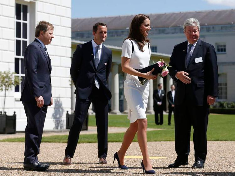The Duchess of Cambridge (second right) as Sir Ben Ainslie (second left) Sir Charles Dunstone, co-founder of Carphone Warehouse (left) and Sir Keith Mills, entrepreneur and deputy chairman of London Organising Committee of the 2012 Olympic Games look on as they leave the National Maritime Museum in Greenwich, London, after the launch of British challenger team for the 35th America's Cup.