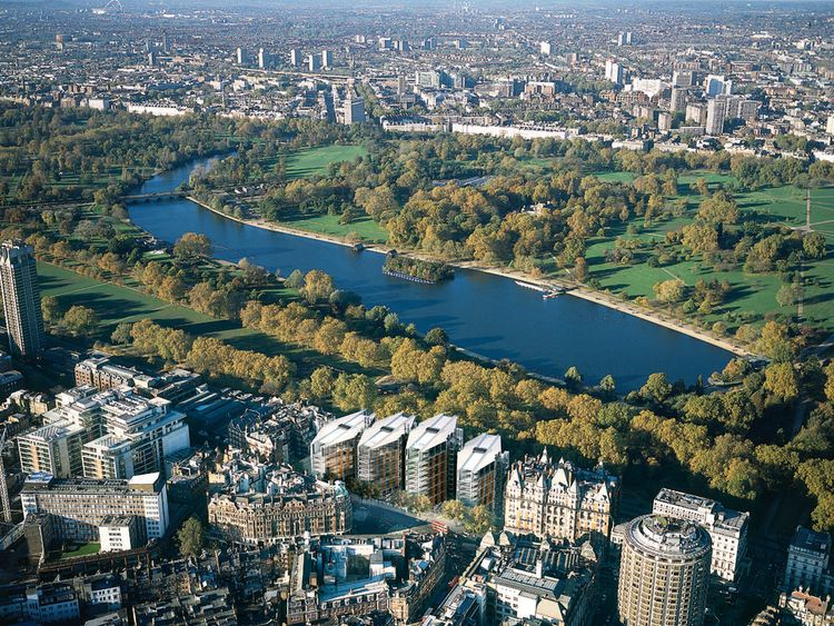 One Hyde Park in the foreground before the Serpentine in London