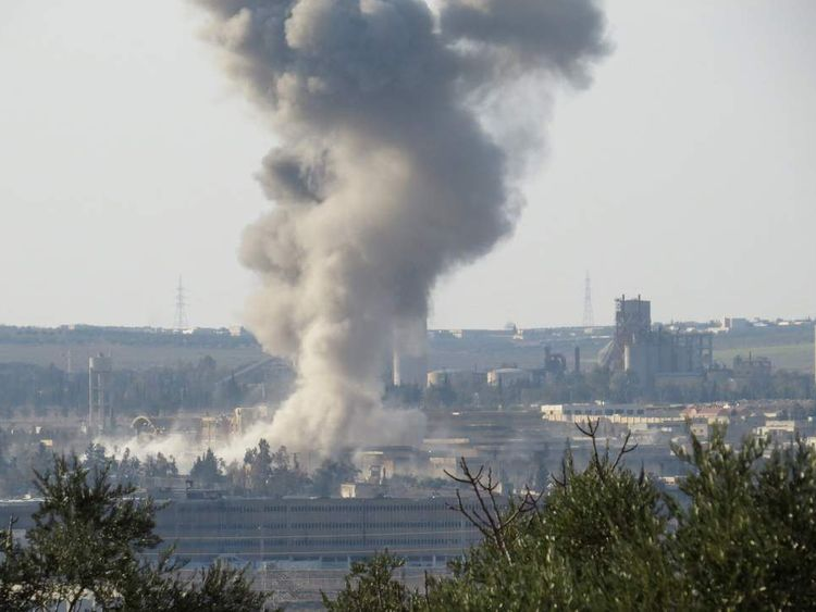 Smoke rises from Aleppo's central prison in Syria