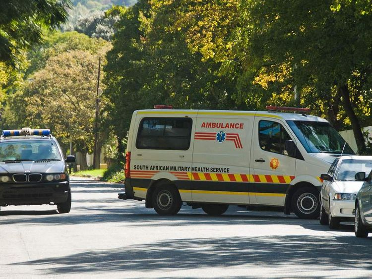 An ambulance believed to be transporting former president Nelson Mandela arrives at his home in Johannesburg