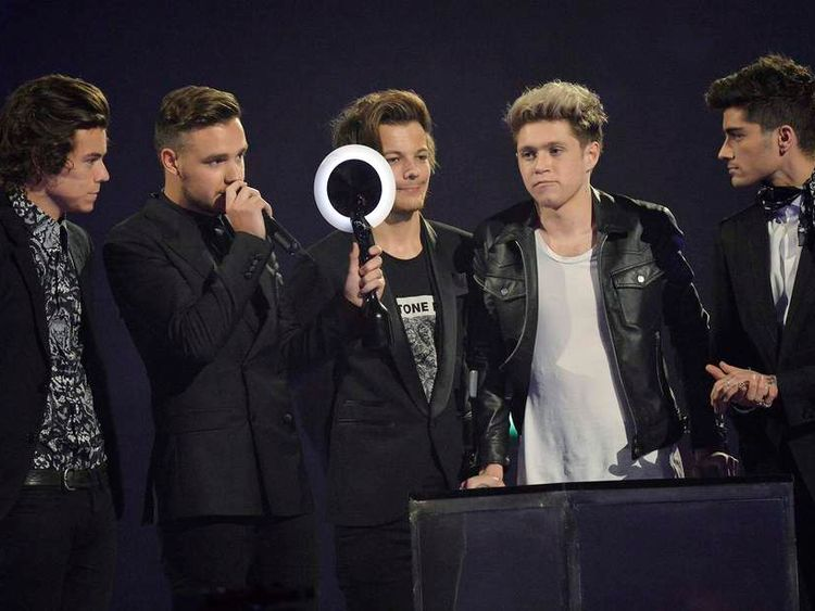 Members of One Direction react after being presented with the British Video award at the BRIT Awards in London