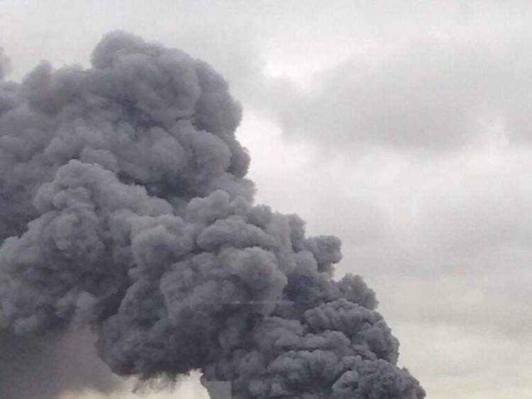 Smoke rises from the scene of a major fire in Newport Pagnell. Pic: David Pacey