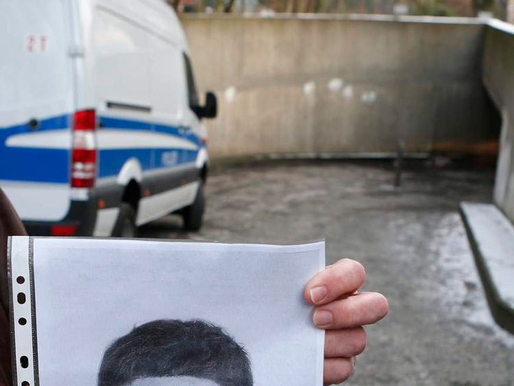 Police spokesman displays composite sketch of suspect involved in digging of tunnel leading to safe deposit room of a bank in Berlin