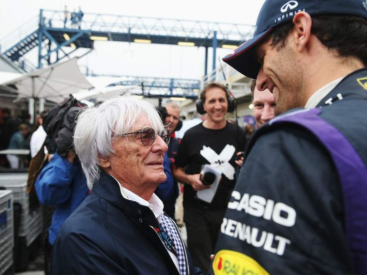 Mark Webber of Australia and Infiniti Red Bull Racing talks with F1 supremo Bernie Ecclestone