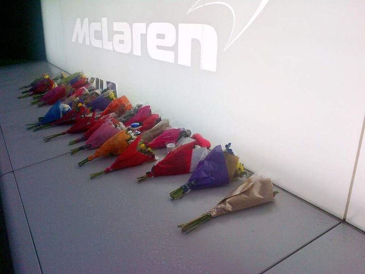 Floral tributes were left after two McLaren workers died in a crash near the company's Woking HQ. Pic: McLaren/Twitter