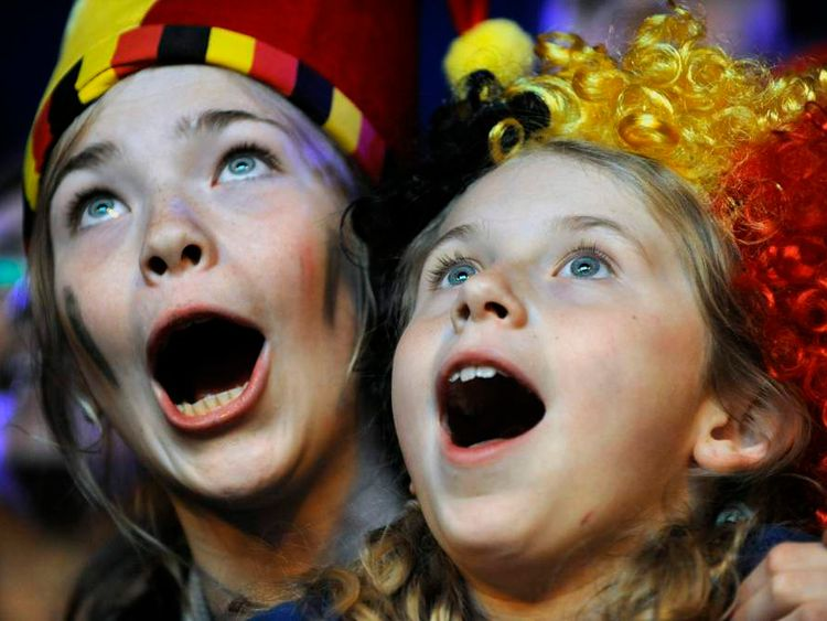 Belgian supporters celebrate after Belgium beat USA in their 2014 World Cup match, at the Saint Job place in Brussels