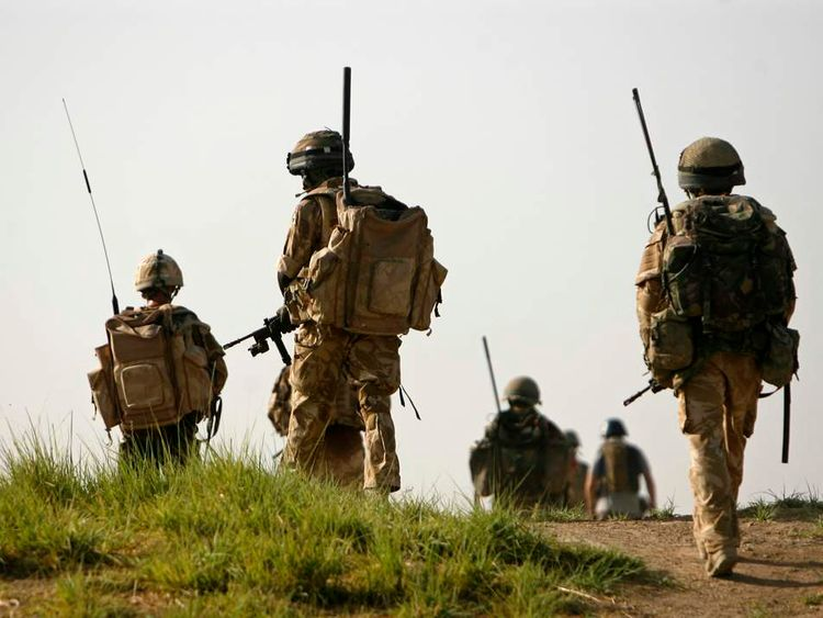 British soldiers from A Company, 2 Mercian patrol in the Babaji village in Helmand province