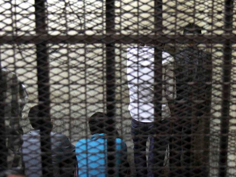 Five defendants stand behind bars for attacking women in Cairo