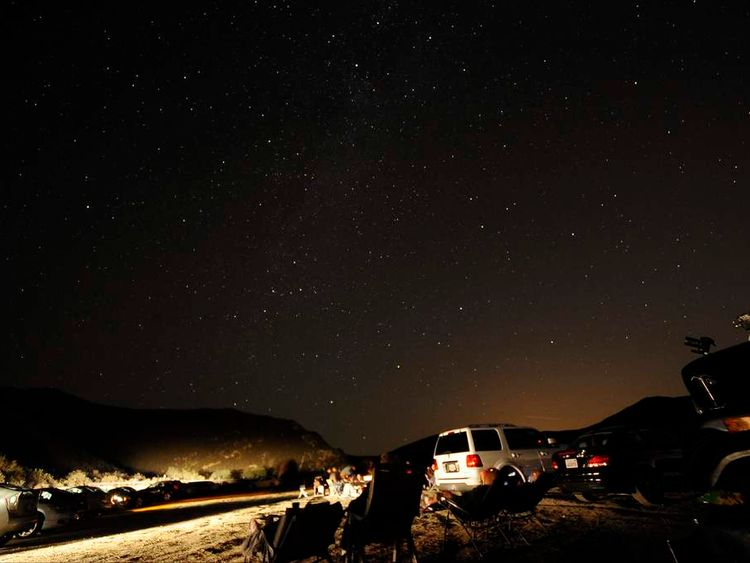 Stargazers come out to watch the Perseid meteor shower north of Castaic Lake, California, 2013