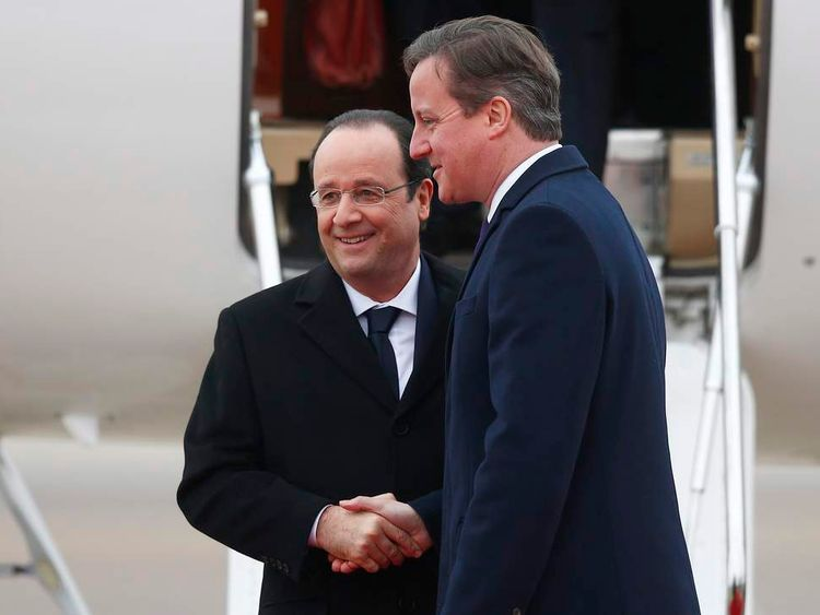 David Cameron greets Francois Hollande at RAF Brize Norton, near Oxford