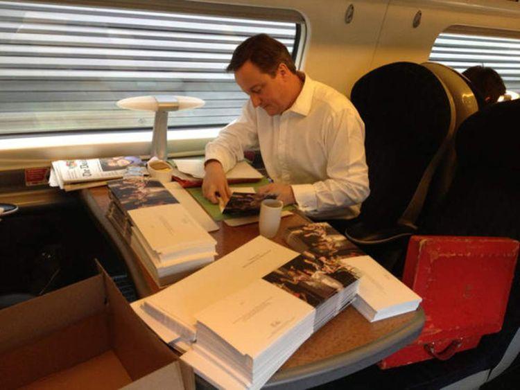 David Cameron signing his Christmas cards.