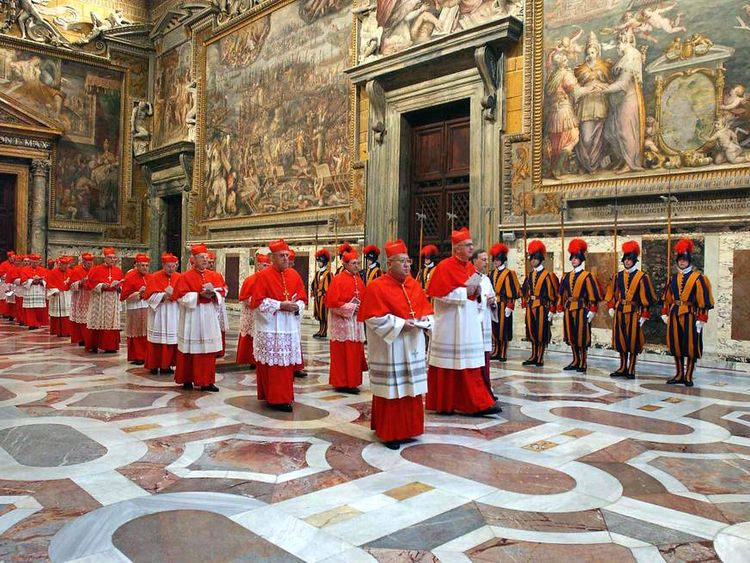 The elector cardinals go to the Sistine Chapel in 2005