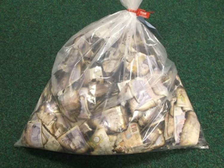 A bundle of the cash tied up in a bag