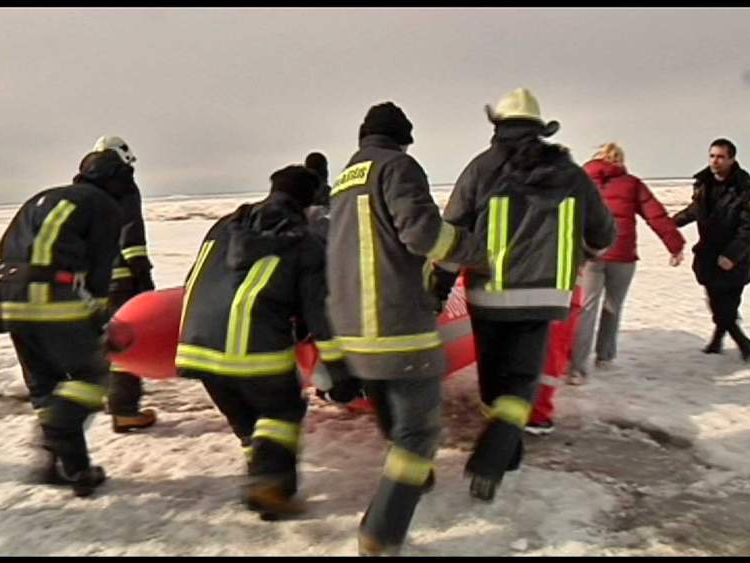 Rescuers pictured after two ice blocks drift off Latvian coast