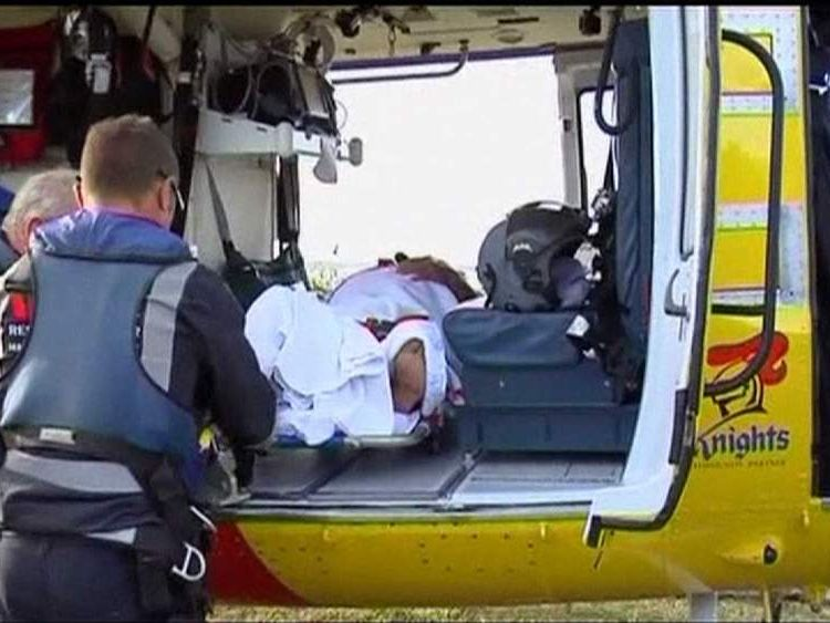 Alan Saunders bitten by shark in knee deep water in Australia