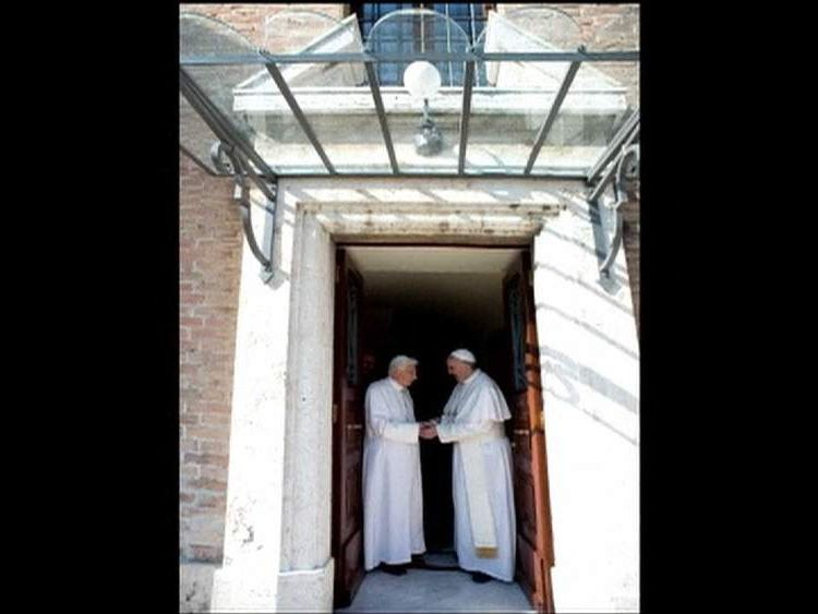 Pope Benedict and Pope Francis.