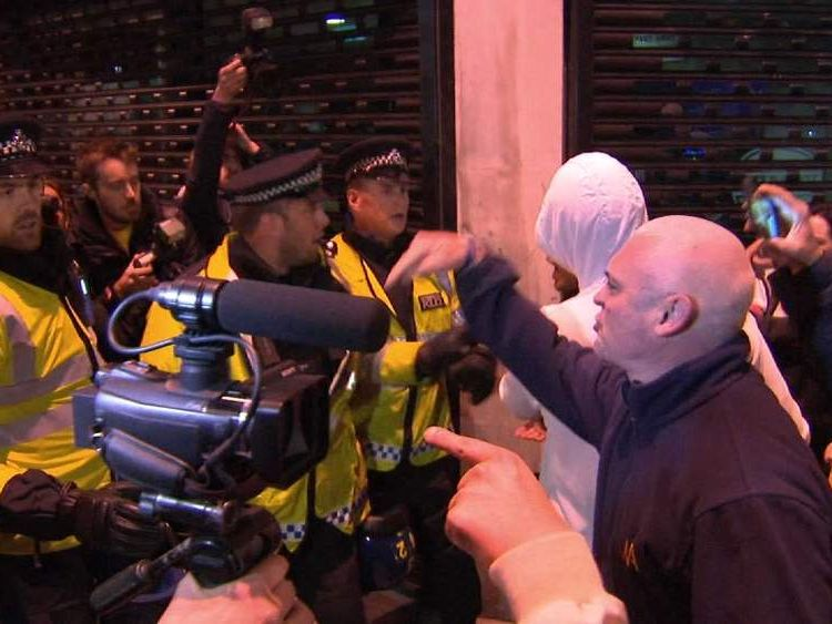 English Defence League protesters are held back by police
