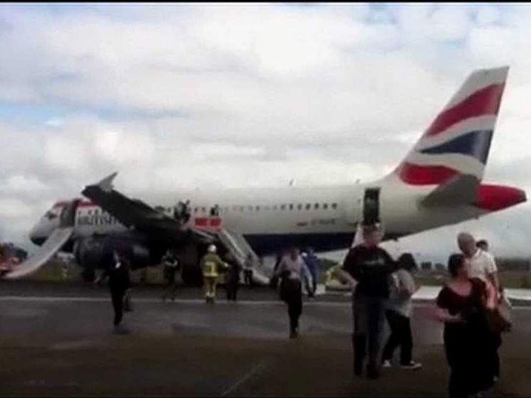 Passengers evacuate British Airways plane after emergency landing at Heathrow