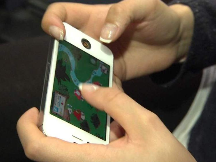 Female playing smartphone game