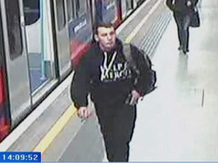 Drummer Lee Rigby, wearing his Help for Heroes top, walks along a London Underground station platform