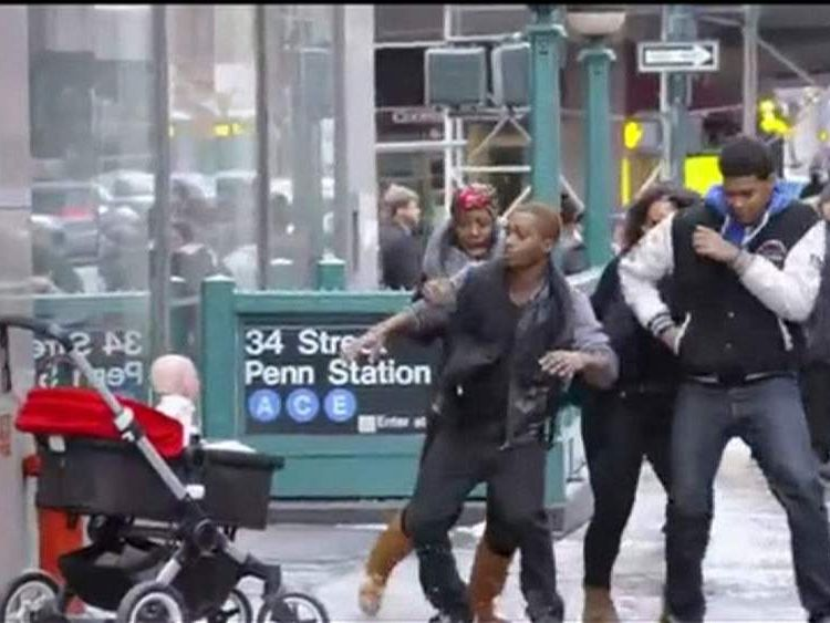 Shock: the Devil Baby leaps out at a group of pedestrians