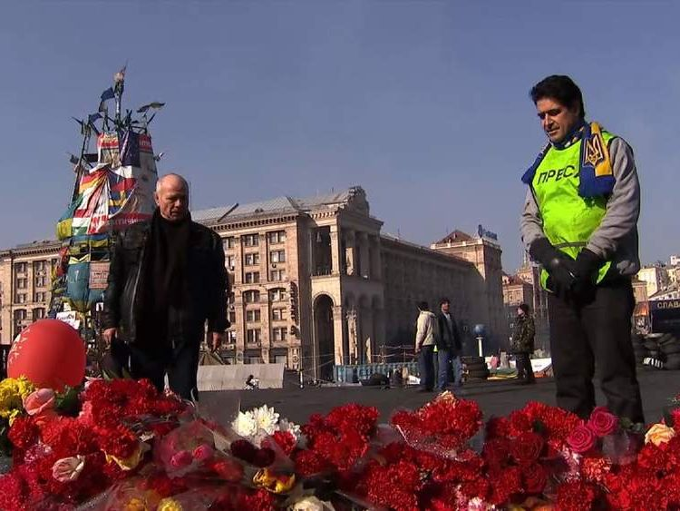 V.K. Demjin Doroschenko, who lives in New Zealand but has returned home to Ukraine, pauses to remember those killed in anti-government protests.