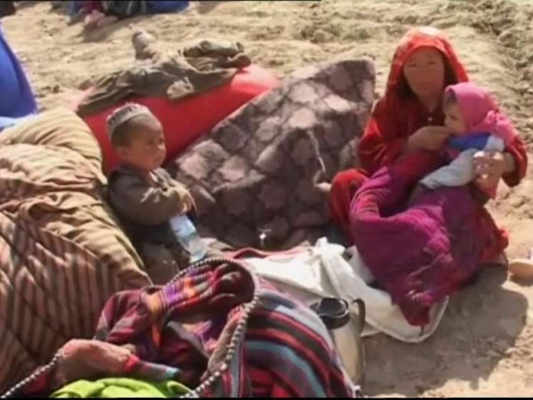A mother and children displaced by the landslide in Afghanistan.