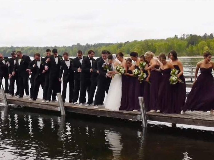 Bride, groom and wedding party fall into lake after jetty collapsed