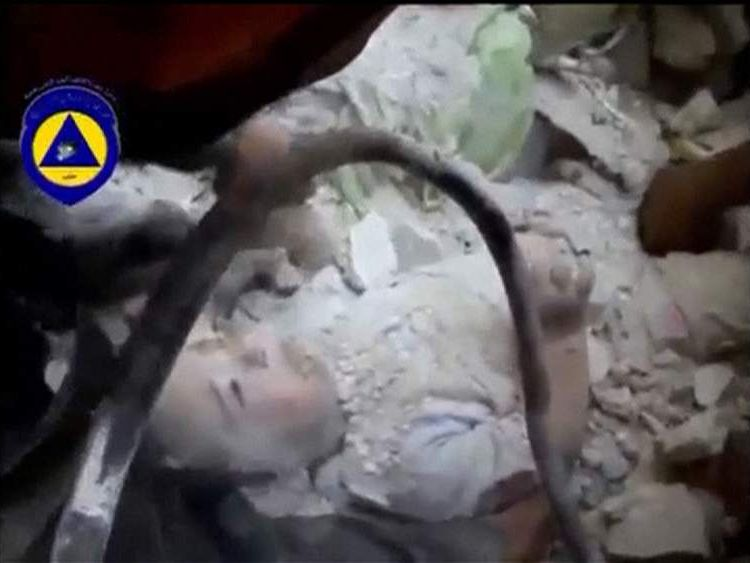 A toddler is rescued from rubble following a bombing in Aleppo