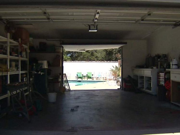 The car shot through the garage into the pool
