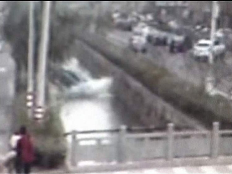 Car plunges into river in China