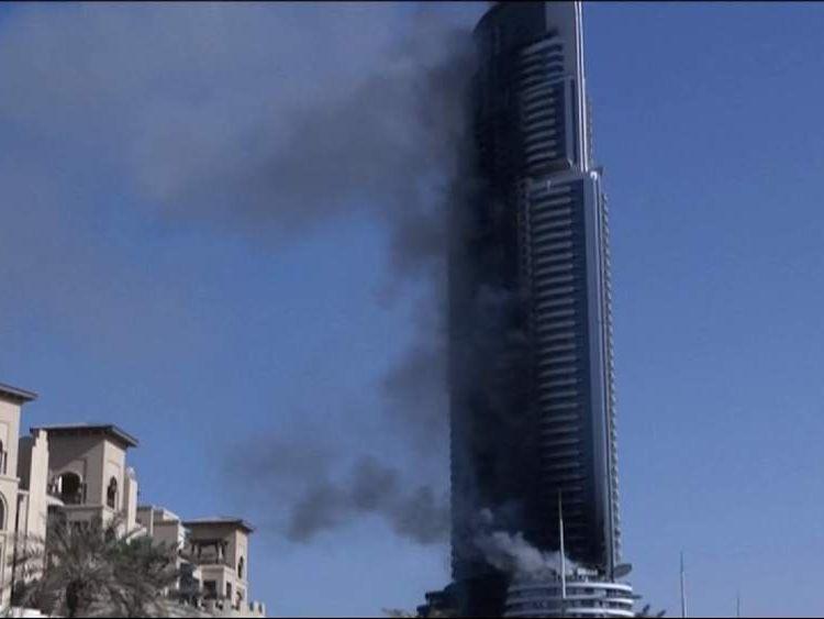 010116 Dubai hotel fire smoking building 1