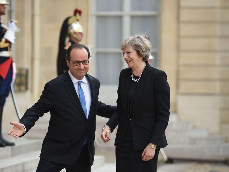 French President Francois Hollande welcomes Prime Minister Theresa May to the Elysee Palace in Paris on her first foreign trip since taking office