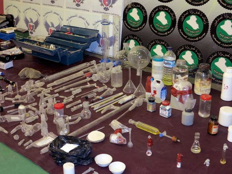 Laboratory equipment and chemicals are seen on display during a news conference at the Defence Ministry in Baghdad