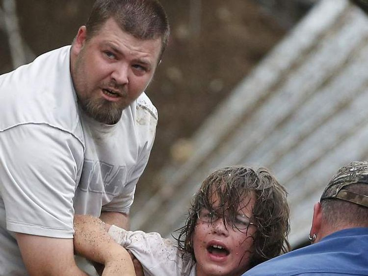 A child calls to his father after being pulled from the rubble of the Tower Plaza Elementary School following a tornado in Moore, Oklahoma