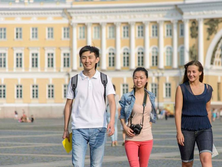 A Chinese young man and young woman with European friend in St Petersburg