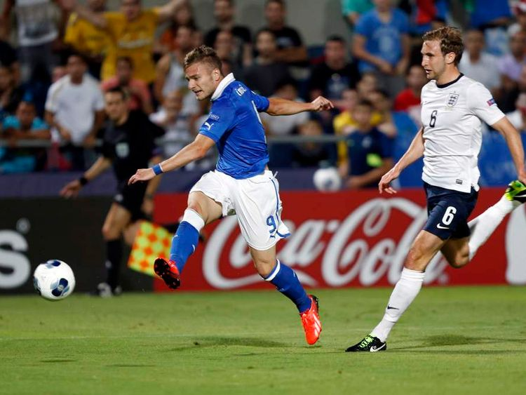 Italy's Ciro Immobile kicks the ball as England's Craig Dawson challenges during their European Under-21 Championship soccer match at the Bloomfield Stadium in Tel Aviv
