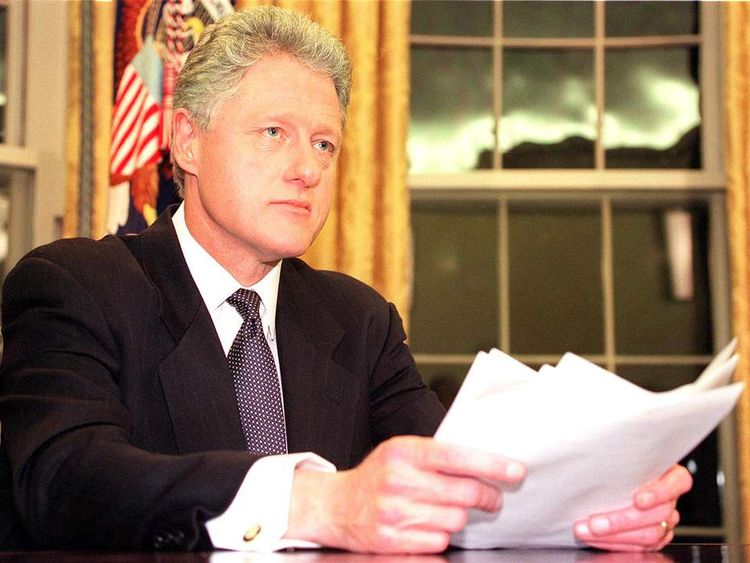 US President Bill Clinton prepares to address the