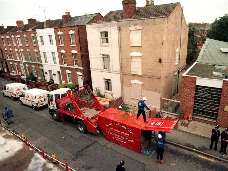 "Workmen unload equipment outside 25 Cromwell Street in Gloucester October 6. Britain's ""House of Hor.."