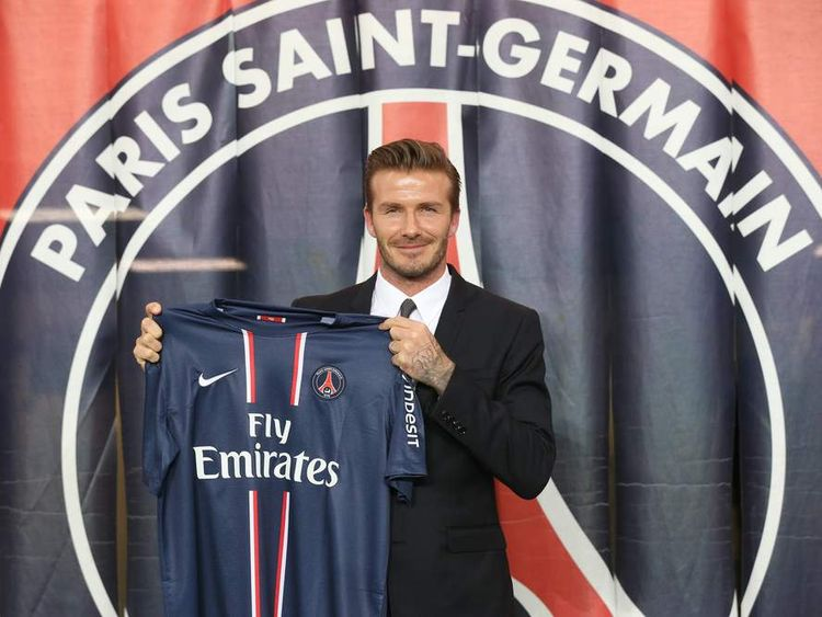 Davod Beckham poses with his new Paris Saint-Germain (PSG) jersey.