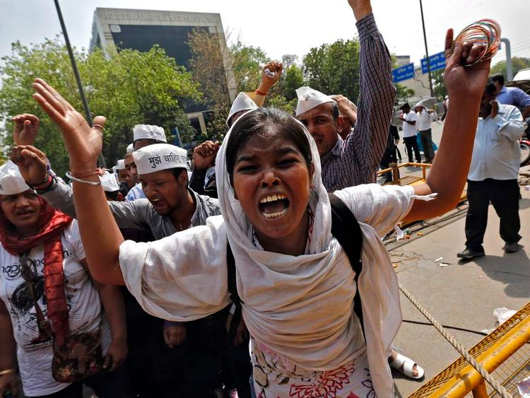 A woman protests outside police headquarters in New Delhi over the rape of a five year old