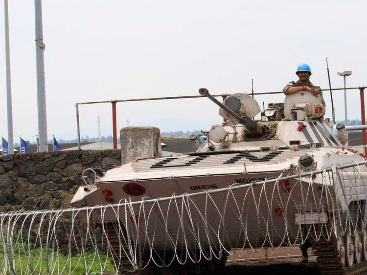 A United Nations armoured vehicle guards a barrier at the entrance of the closed airport in Goma